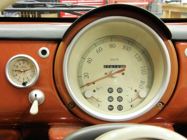 PAO純正スピードメーターにPAO仕様の時計が鎮座した。